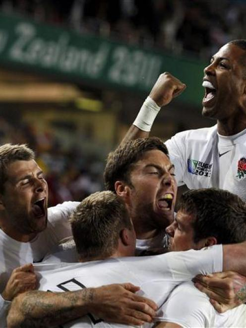 England players celebrate after Chris Ashton's crucial try.   REUTERS/Nigel Marple
