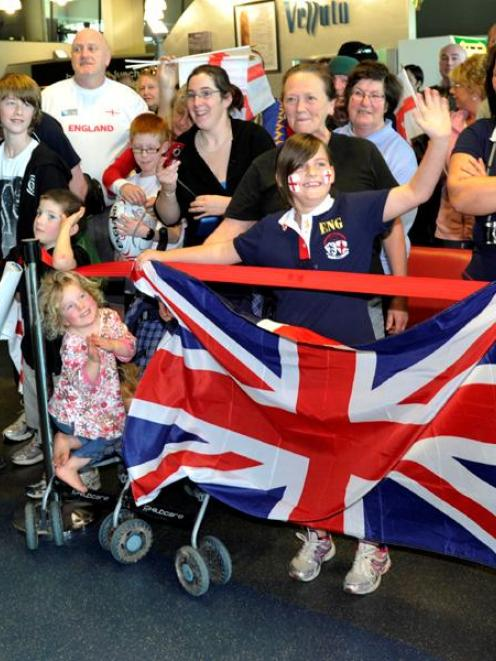 England rugby team supporters show their true colours while greeting their Rugby World Cup heroes...