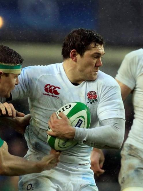 England's Alex Goode (C) holds off Ireland's Brian O'Driscoll during their Six Nations match at...
