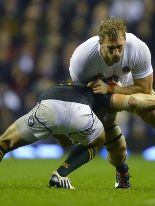 England's captain Chris Robshaw is tackled by South Africa's Pat Lambie during their...