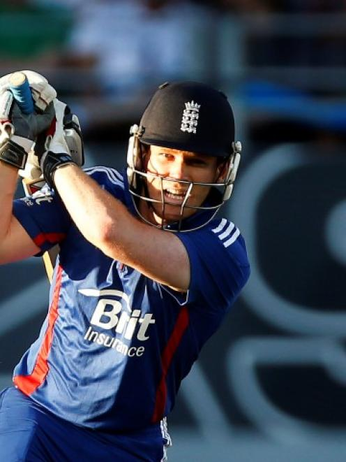 England's Eoin Morgan hits a boundary during their first Twenty20 cricket match against New...