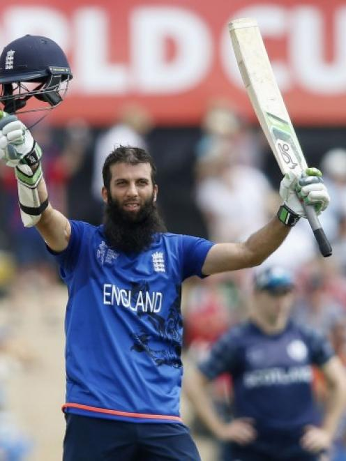 England's Moeen Ali celebrates reaching his century against Scotland in Christchurch. REUTERS...