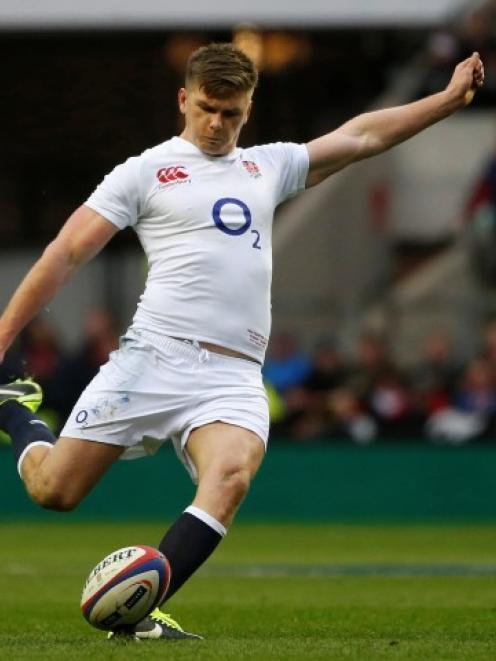 England's Owen Farrell kicks a penalty against Scotland at Twickenham. REUTERS/Eddie Keogh