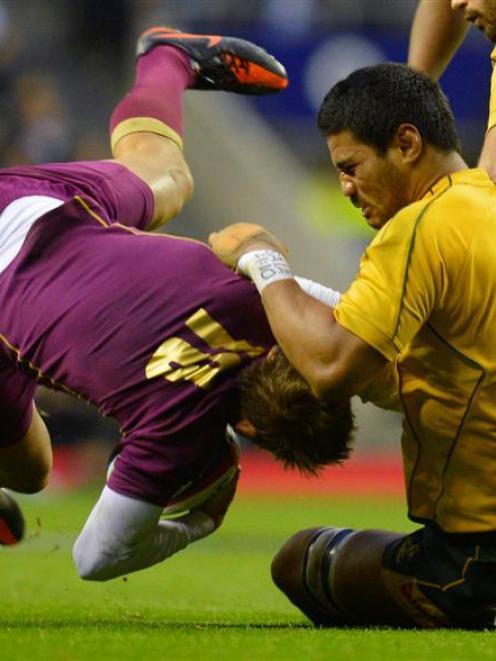 England's Toby Flood is tackled Australia's Sitaleki Timani. REUTERS/Russell Cheyne