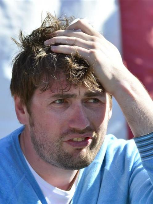 England  supporter Alex Dettman (30), of York, holds his head after being hit by a Hamish...