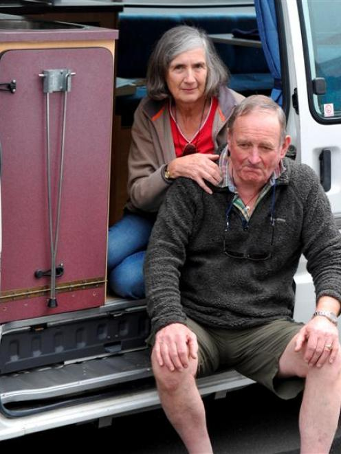 English couple Chris and Jenny Burrows with their camper van yesterday. Photo by Craig Baxter.