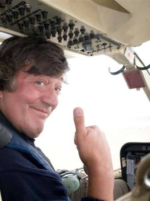 English wit Stephen Fry on his way to Codfish Island on Monday to film a BBC documentary series...