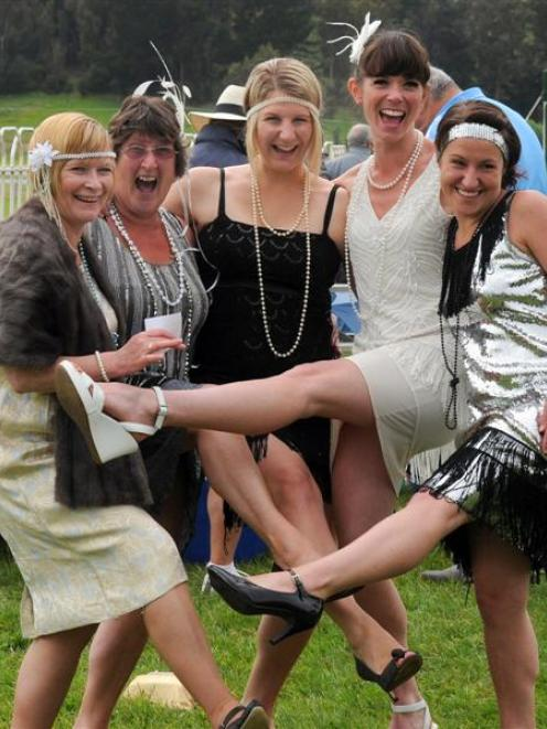 Enjoying  the Boxing Day races at Wingatui yesterday are (from left) Liz Dougherty, Linda Hassan,...