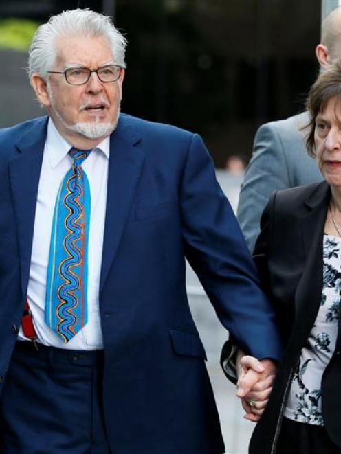 Entertainer Rolf Harris and his wife Alwen Hughes arrive at Southwark Crown Court in central...