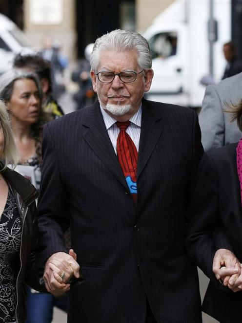 Entertainer Rolf Harris arrives with his daughter Bindi (left) and niece Jenny at Southwark Crown...