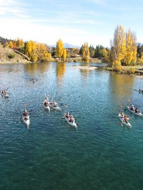 Entrants in the four-day Wild Descent kayak race on the Clutha River approach the starting line...