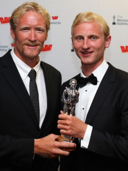 Eric Murray (L) and Hamish Bond pose with the Halberg Award for Team of the Year during the 2013...