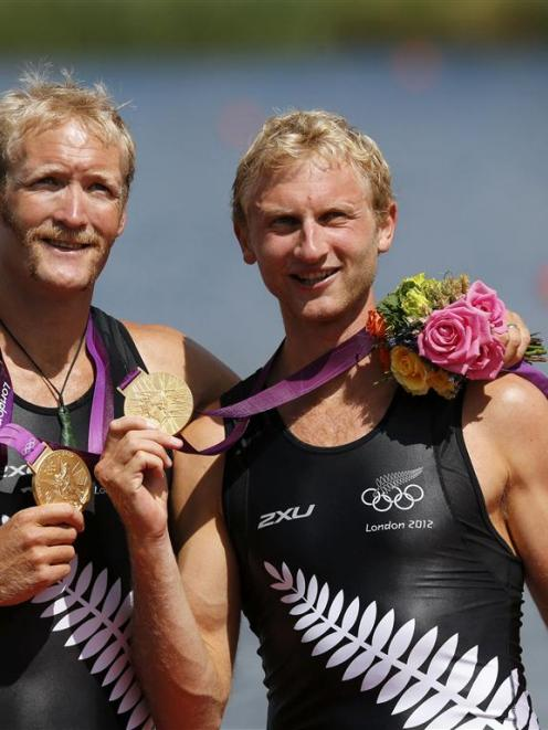 Eric Murray (left) and Hamish Bond of New Zealand celebrate during the medals ceremony after...