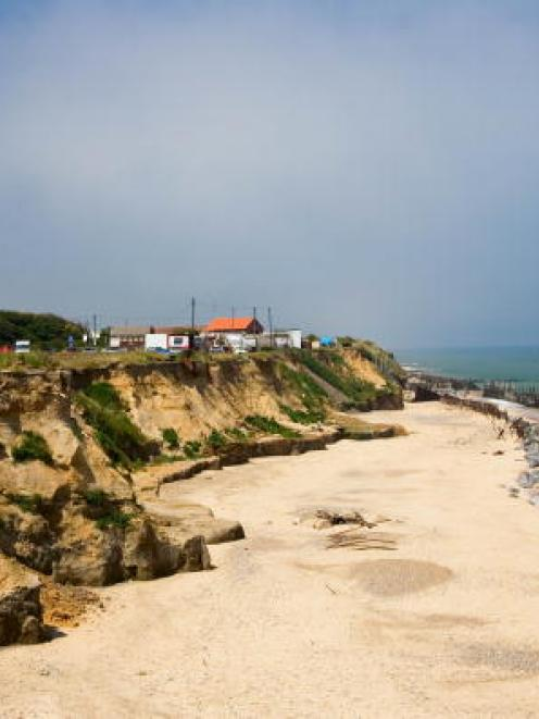 Eroded shoreline at Happisburgh in England, where scientists have found what they believe to be...