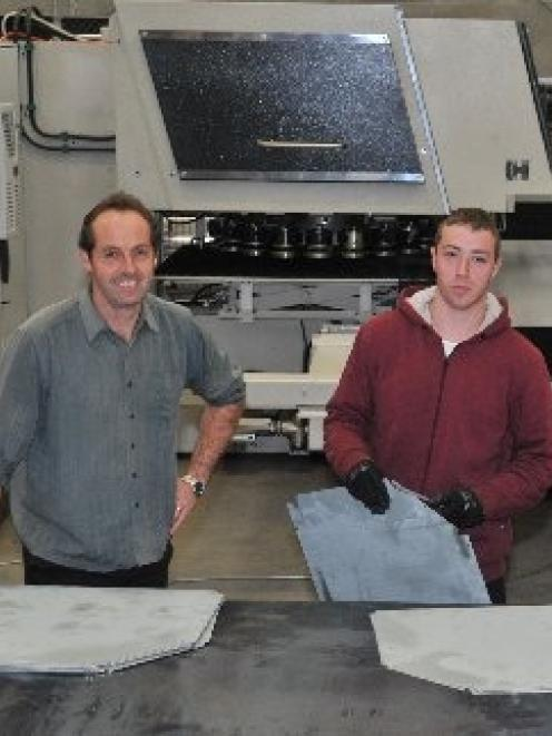 Escea operations manager Mark Davie (left) and CNC machine operator Ryan Savage with the new...