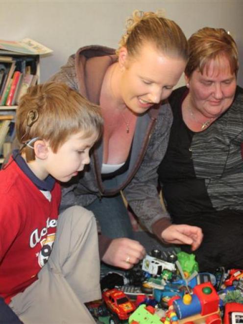 Ethan Murphy-Sakkers plays with his mother, Annika Murphy, and grandmother Debora Murphy.
