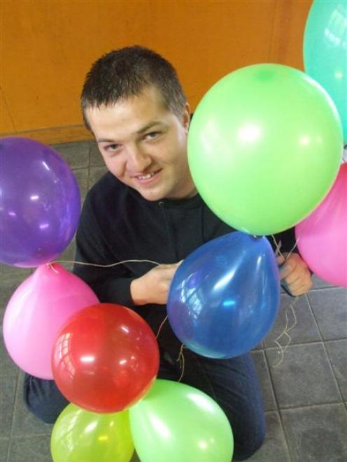 Eugen Dupu is hoping to establish a world record by having at least 10,000 inflated balloons in...