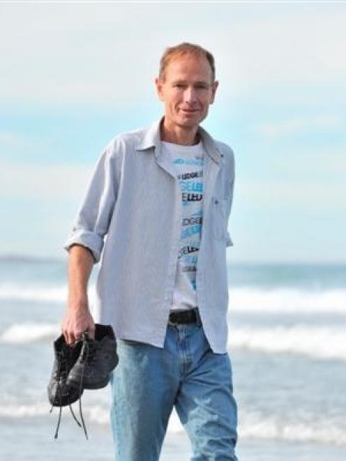Euthanasia advocate Prof Sean Davison walks in the water at St Clair Beach yesterday on his first...
