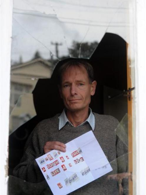 Euthanasia law reformer Sean Davison yesterday with a death threat he received in the post last...
