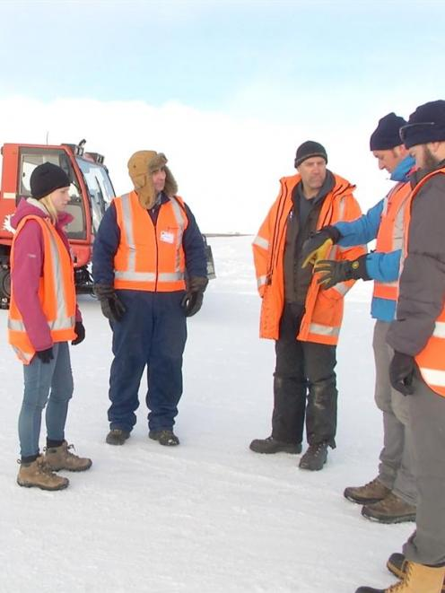 Evaluating geological research equipment in snow before it is taken to the Antarctic are (from...