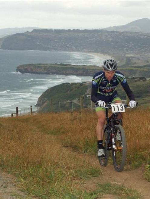 Eventual winner Brendon Sharratt (Christchurch) near the top of Karetai Track during last summer...