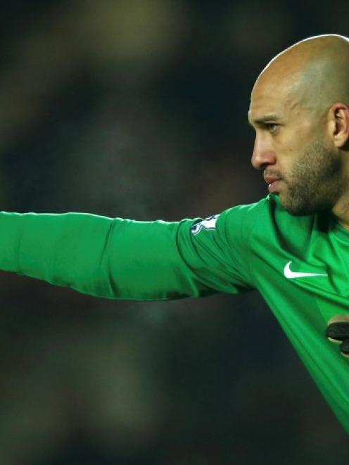 Everton's keeper Tim Howard shouts instructions during their English Premier League match against...