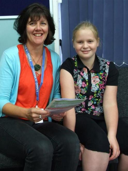 Evie Connor (12) discusses her HPV vaccination with public health nurse Marion O'Kane at Outram...