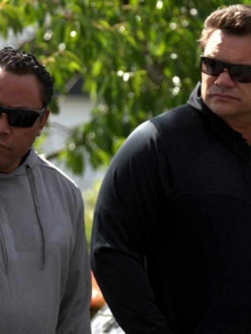Ex-All Blacks Ofisa Tonu'u and Michael Jones pay their respects at Lomu's home. Photo / Dean Purcell