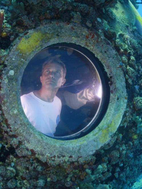 Fabien Cousteau is pictured inside the marine laboratory Aquarius in this undated handout photo...