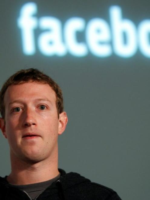 Facebook CEO Mark Zuckerberg listens to a question after introducing a new feature called 'Graph...