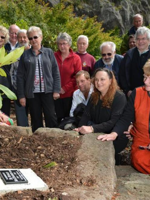 Family and friends of Ronald MacDiarmid gather around the plaque and the Alem Stormcloud...