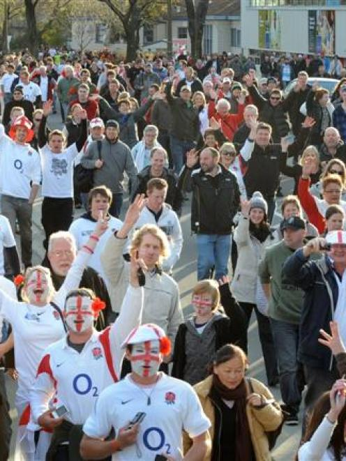 Fans pour towards Otago Stadium ahead of the Rugby World Cup clash between England and Georgia in...