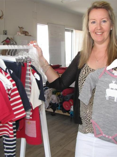 Fashion designer Christina Perriam with some of her Suprino Bambino range of merino clothing for...