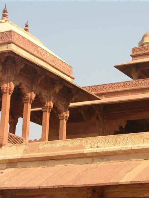 Fatehpur Sikri, meticulously carved in pink stone, was once the glorious capital of the Indian...