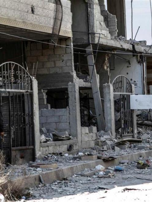 Fee Syrian Army fighters inspect the damage after an air strike by Syrian President Bashar al...