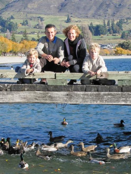 Feeding ducks on the Wanaka jetty are (from left) Joseph (3), Steve, Steph and Alexander (8)...