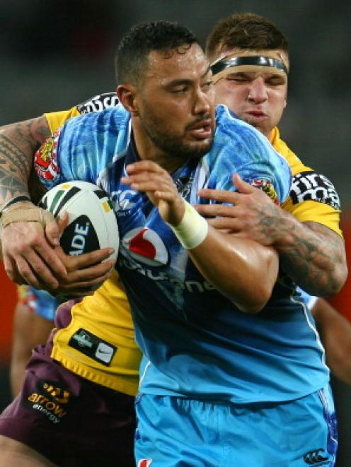 Feleti Mateo of the Warriors tries to break out of a tackle during the NRL trial match against...