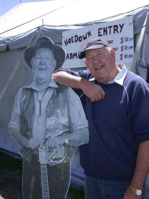 Ferg Mitchell (right and left) welcomes country music fans to the 25th anniversary of the Merino...