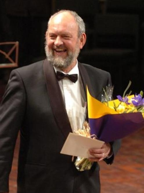 Festival music co-ordinator Aart Brusse receives a long service award for his work. Photo by...
