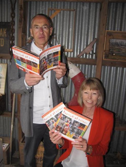 Festival of Colour director Philip Tremewan (left) and chairwoman Hetty van Hale hold brochures...