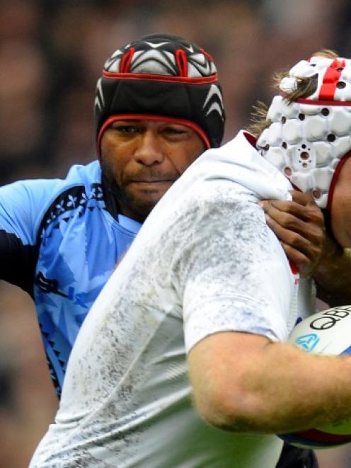 Fiji's Deacon Manu tackles England's Thomas Waldrom (R) during their rugby test at Twickenham...