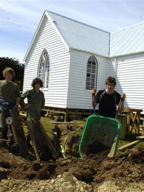 Finishing off excavations at Pukehiki Church on Otago Peninsula are (from left) 18-year-olds Fin...