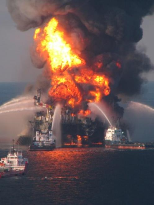 Fire boat response crews battle the blazing remnants of the offshore oil rig Deepwater Horizon,...