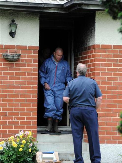 Fire safety and police officers at the scene of a Mosgiel house fire. Photo by Craig Baxter.