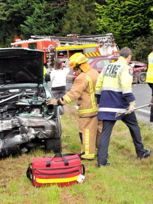 Fire Service personnel inspect an Isuzu Bighorn 4WD following a crash on Puddle Alley near...