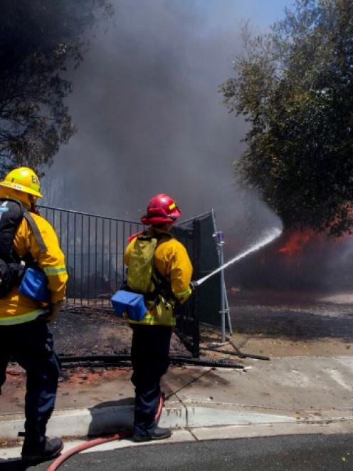 Firefighters battle a blaze in Carlsbad, California. REUTERS/Sam Hodgson