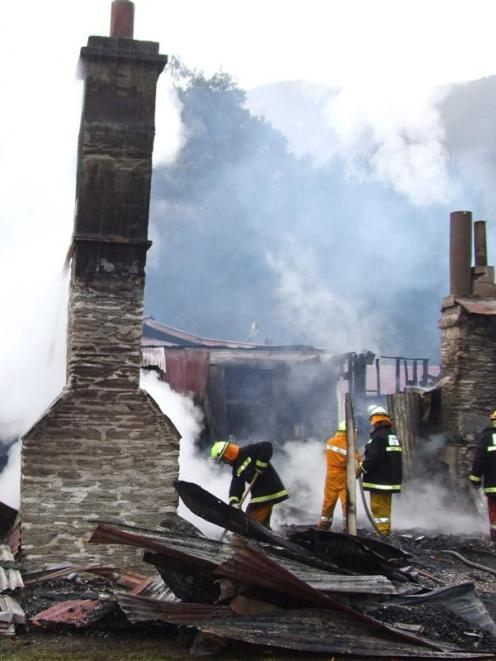 Firefighters  work to control the blaze at the Paradise homestead. Photo by the ODT.