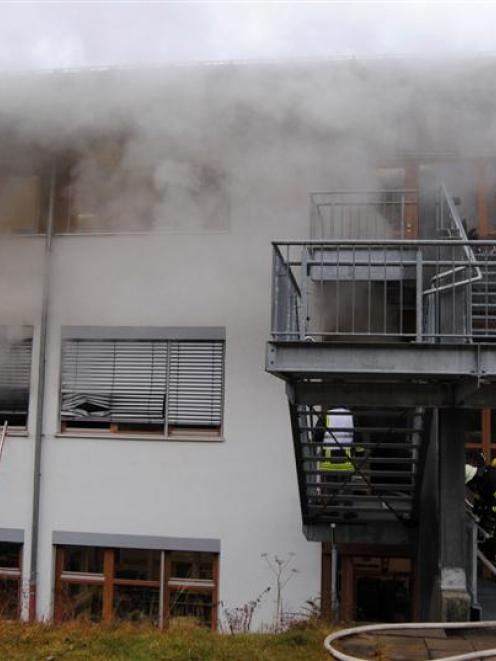 Firemen attend the scene of a fire at a workshop for disabled people in Titisee-Neustadt in the...