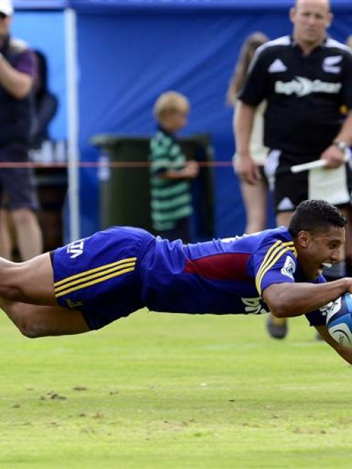 First five-eighth Lima Sopoaga dives over the line to score against the Crusaders. Photos by...