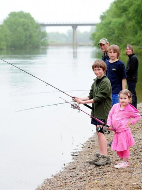 Fishing family (from front) Kate (4), Tim (11), Pete (13), Rob and Dawn Coates try their luck in...